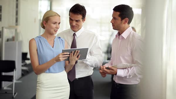 Business colleagues collaborating with use of digital tablet Royalty-free stock video