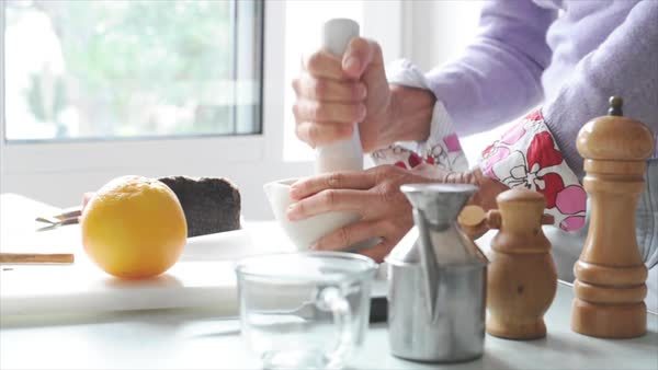 Woman using mortar and pestle to grind ingredients Royalty-free stock video