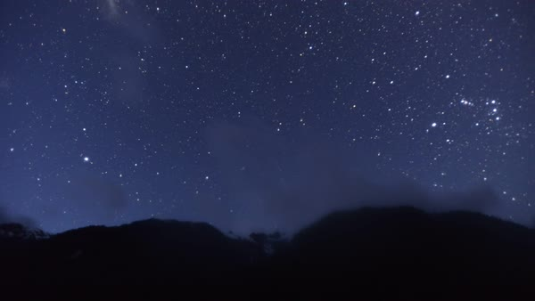 Star filled night sky fades as sun rises Royalty-free stock video