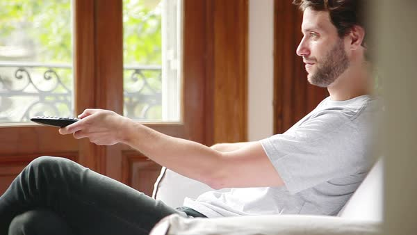 Man watching sports match on tv at home Royalty-free stock video