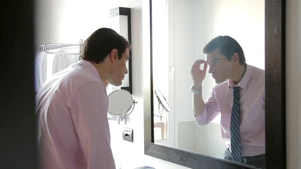 Man looking at self in mirror Royalty-free stock video
