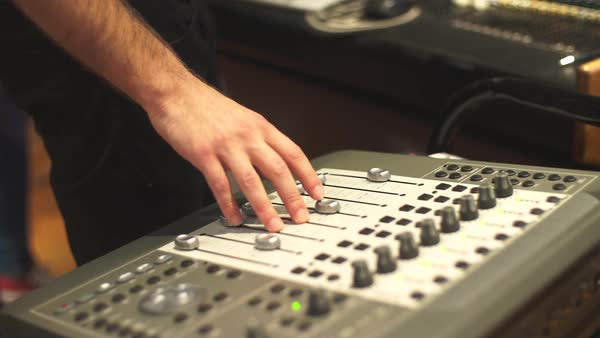 Sound engineer working with mixing board in recording studio Royalty-free stock video