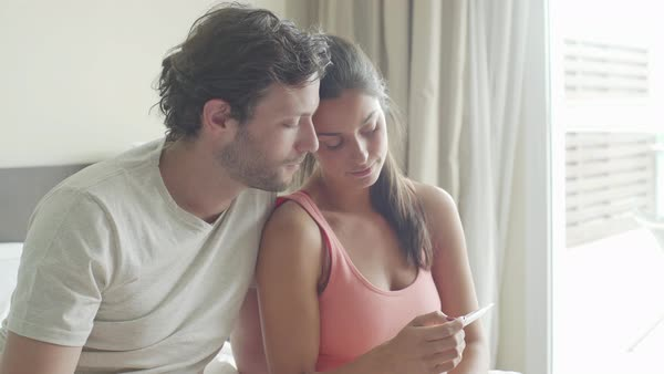 Couple looking at pregnancy test Royalty-free stock video