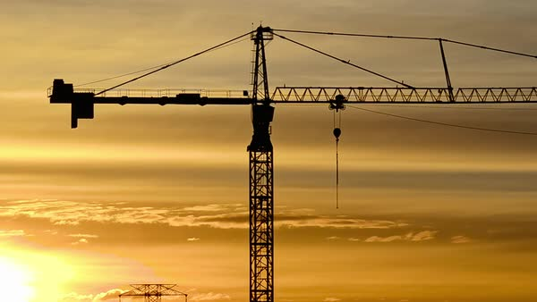 Wide shot of a crane at sunrise Royalty-free stock video