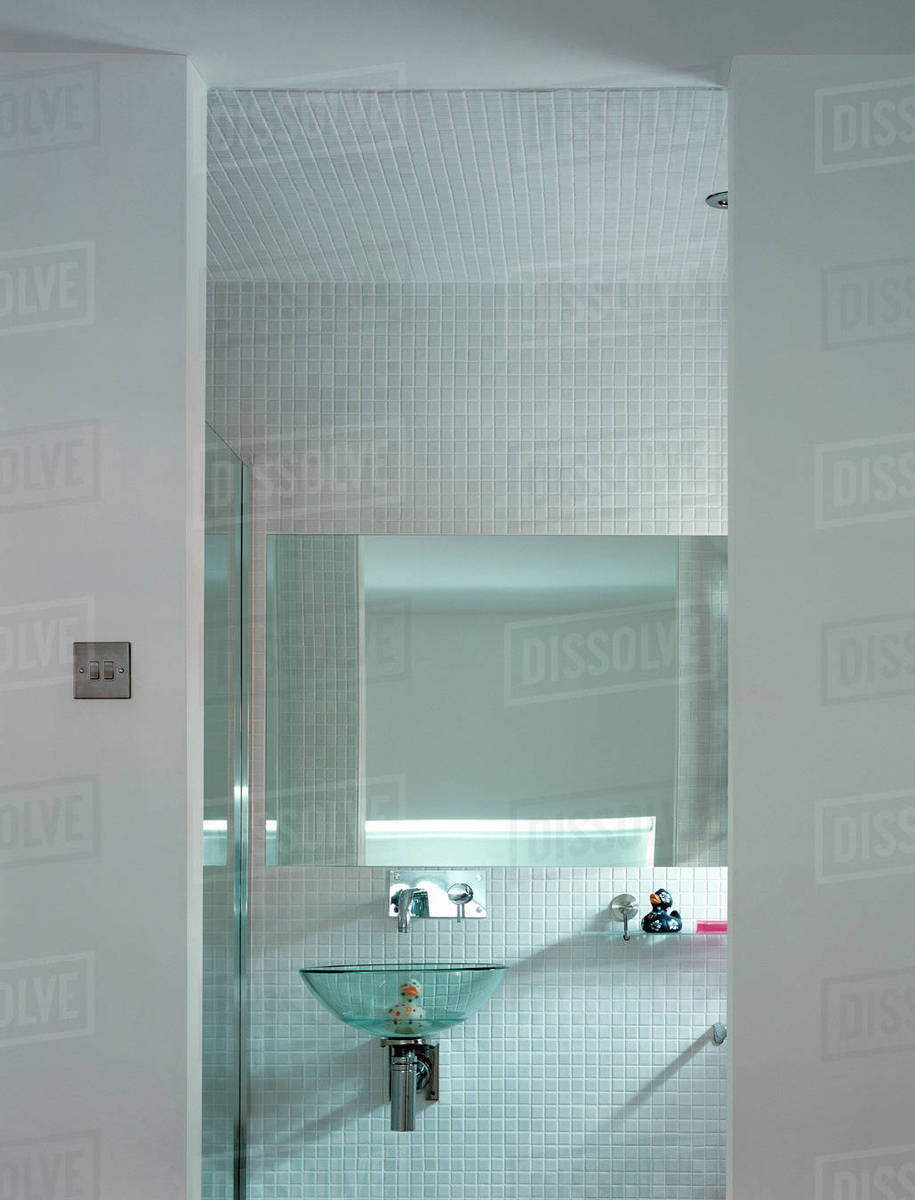 Bathroom with glass basin, mirror and tiles - Stock Photo - Dissolve