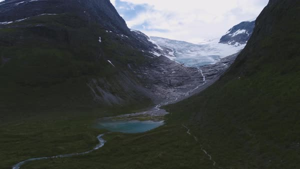 Aerial shot of a stream flowing down from a glacier in Norway Royalty-free stock video
