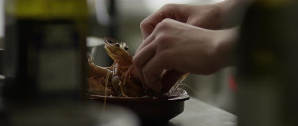 Static shot of a person arranging shrimps in a bowl Royalty-free stock video