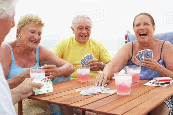 Friends playing cards Royalty-free stock photo