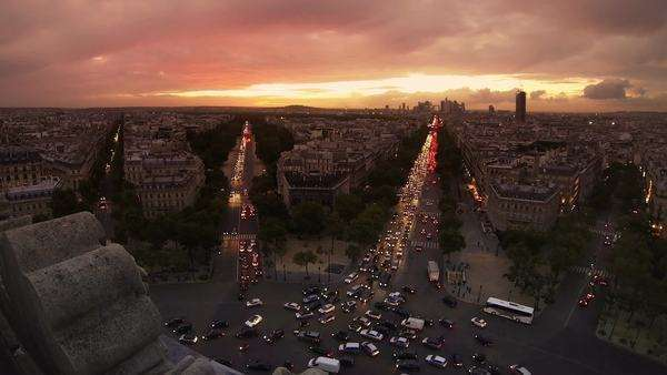 Paris at dusk. Sunset and traffic in Paris from  Arc de Triomphe. Video, not timelapse. Facing downtown Paris with office buildings and clouds. Royalty-free stock video