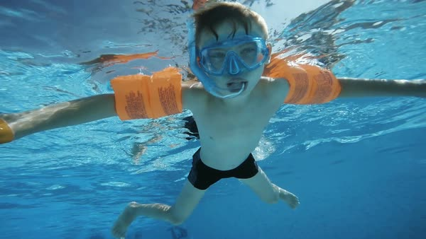 Boy swimming in pool Royalty-free stock video