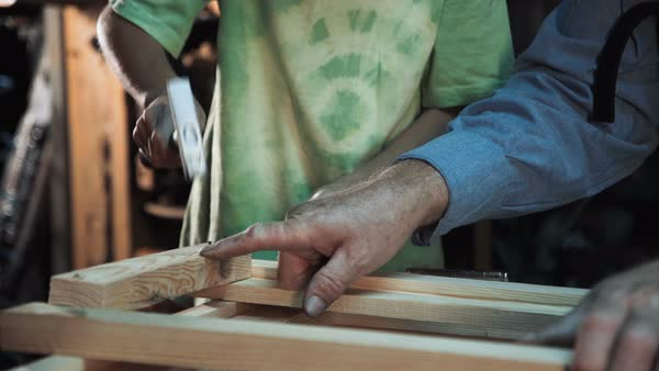 Carpenter and grandson in shop Royalty-free stock video