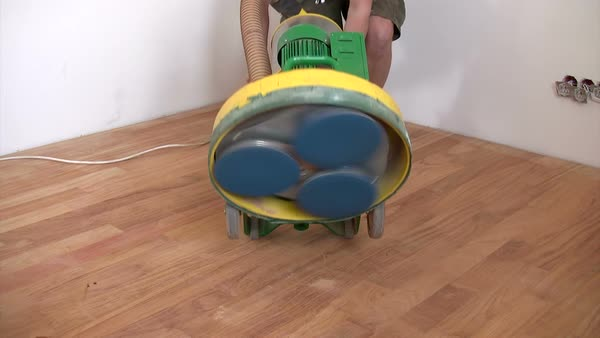 Sander clearing hardwood floor Royalty-free stock video