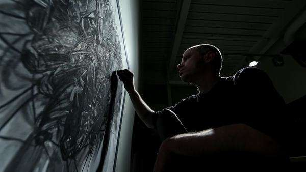 An artist works on a charcoal drawing. Royalty-free stock video