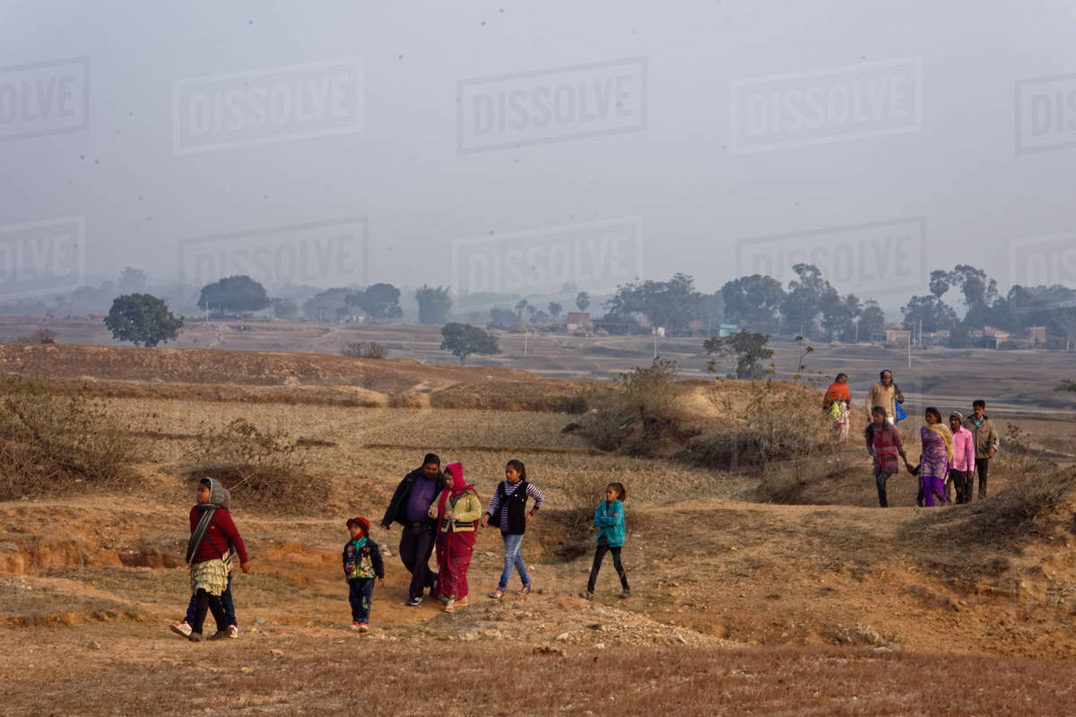 Indian rural  families walking on dry land Royalty-free stock photo
