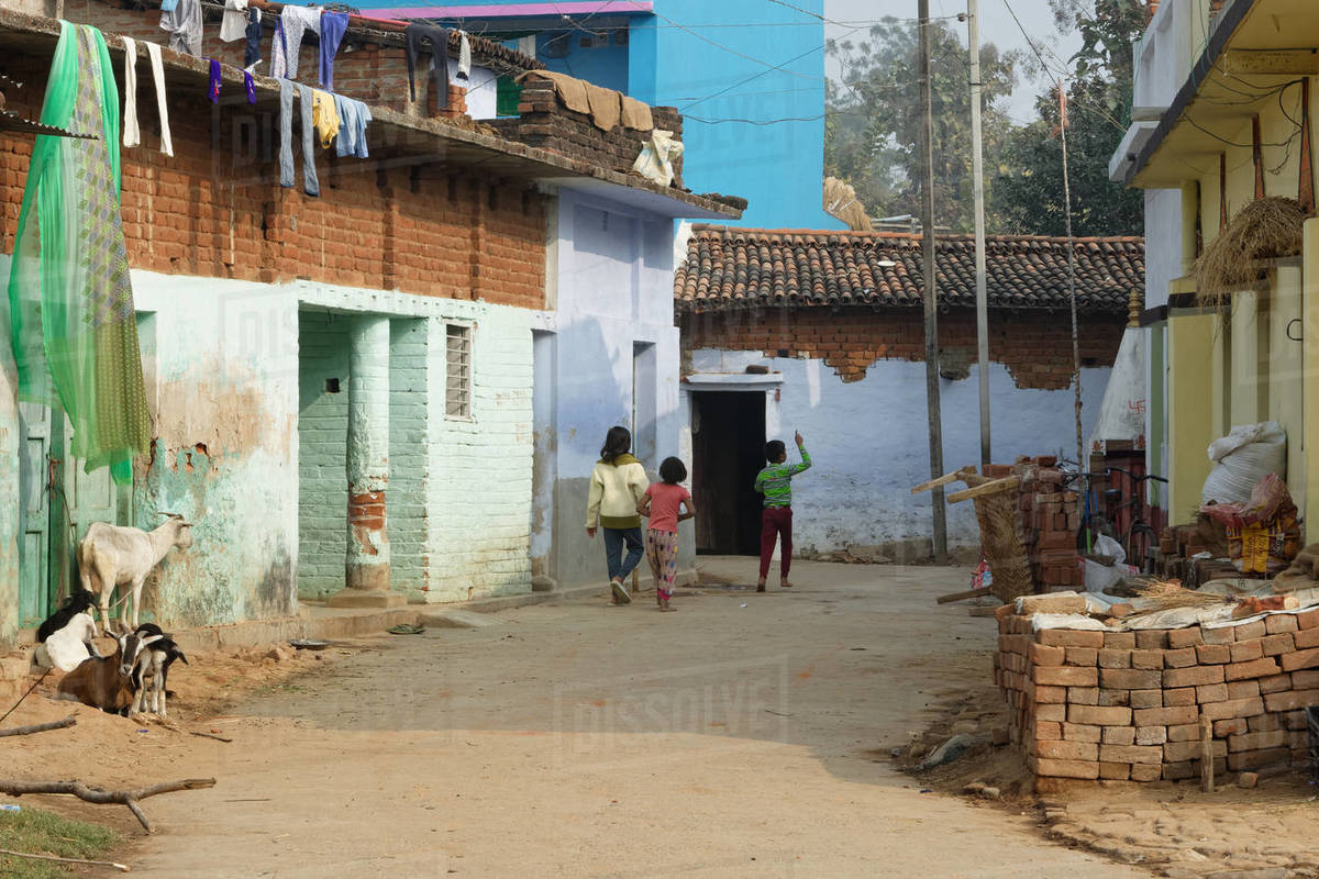 Three yound Indian rural children are returning home in a playful mood Royalty-free stock photo