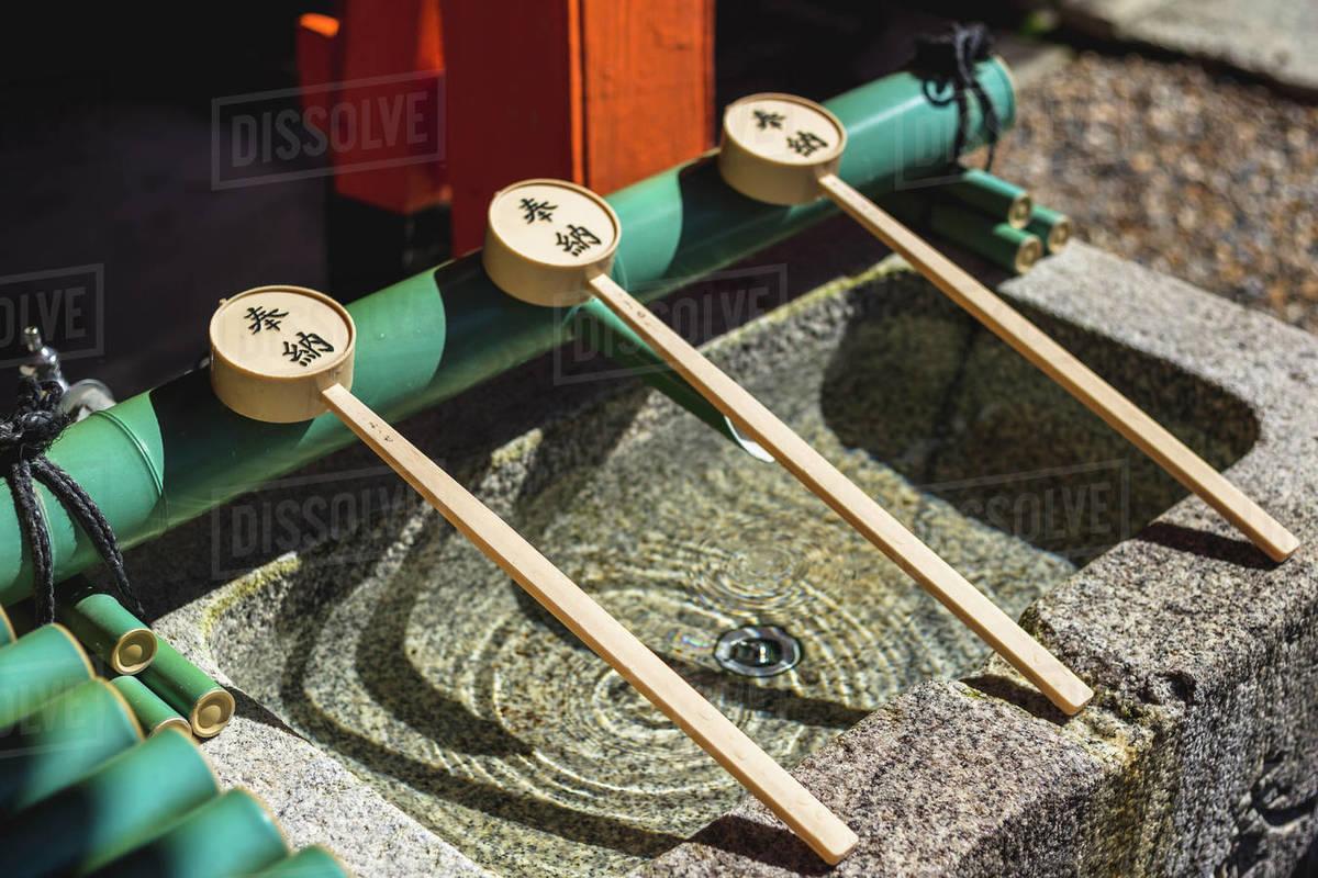 Ladles At A Purification Fountain at Fushimi Inari Shrine In Kyoto Royalty-free stock photo