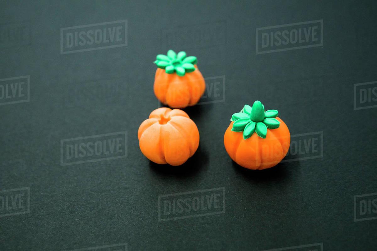 Orange sugar pumpkin under construction on a black background Royalty-free stock photo