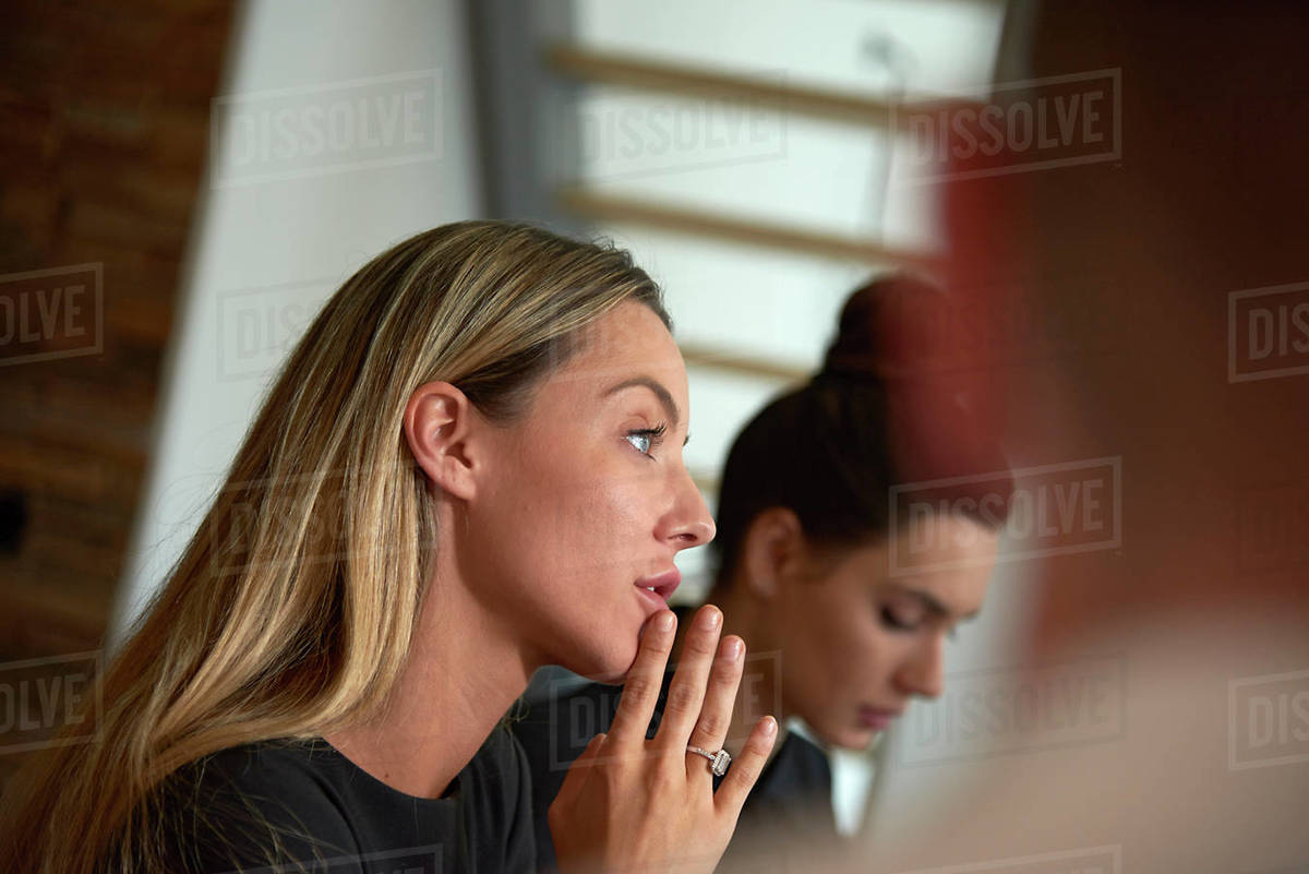 Young business woman in a meeting in a modern office Royalty-free stock photo