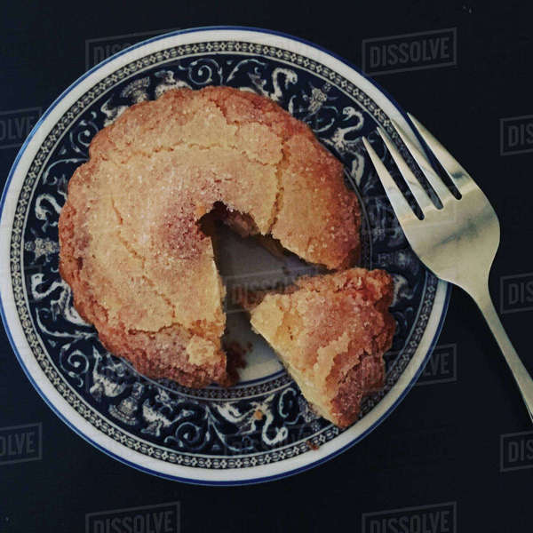 Overhead view of cake in plate with fork on table Royalty-free stock photo
