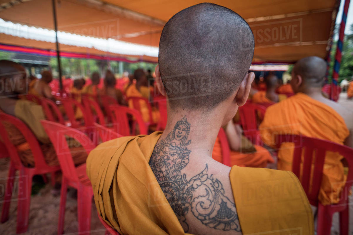 View of a tattoed back of a Buddhist monk, Angkor Wat, Siem Reap, Cambodia. Royalty-free stock photo