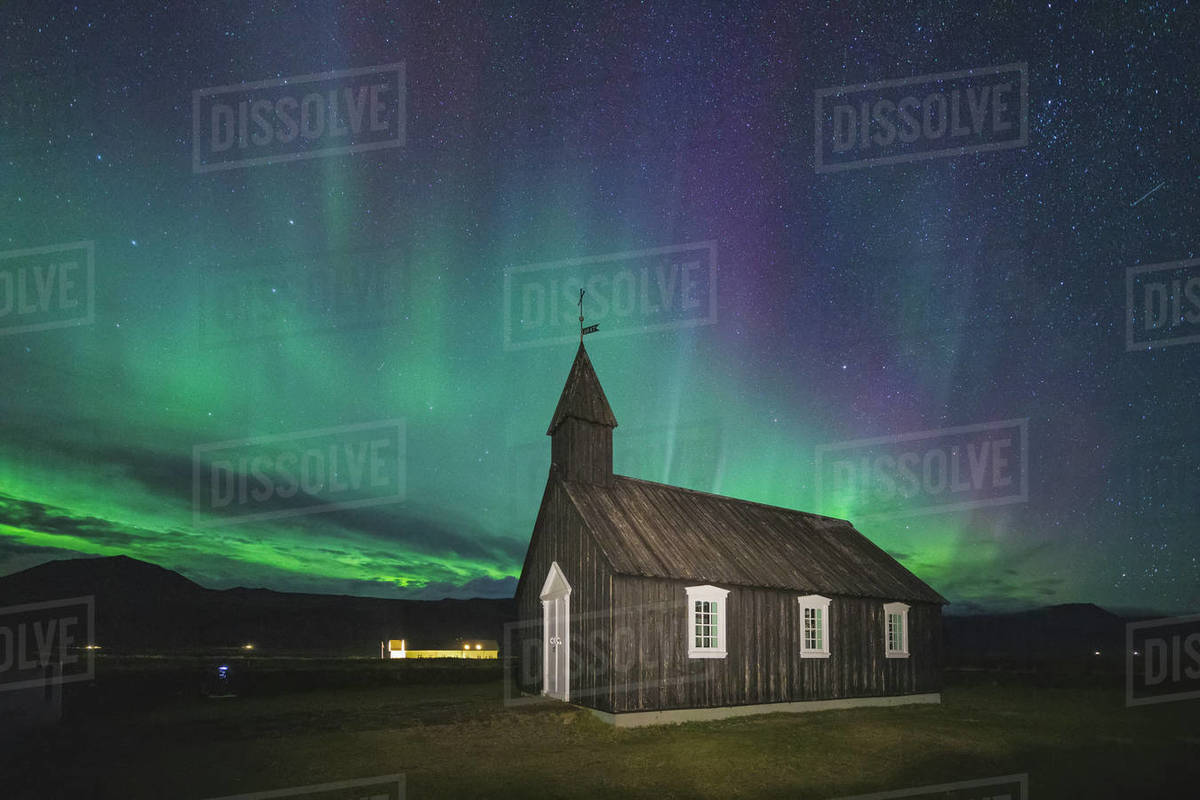 Black church of Budir with aurora borealis Royalty-free stock photo
