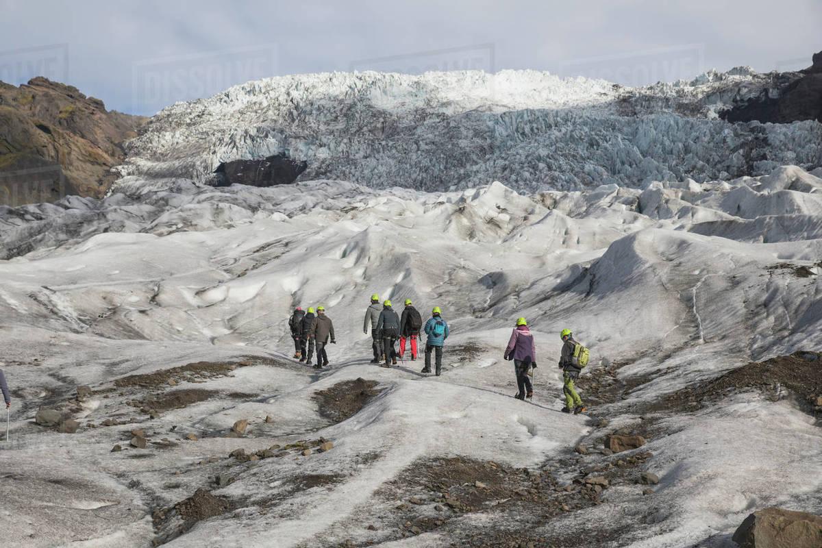 People walking on glacier Royalty-free stock photo