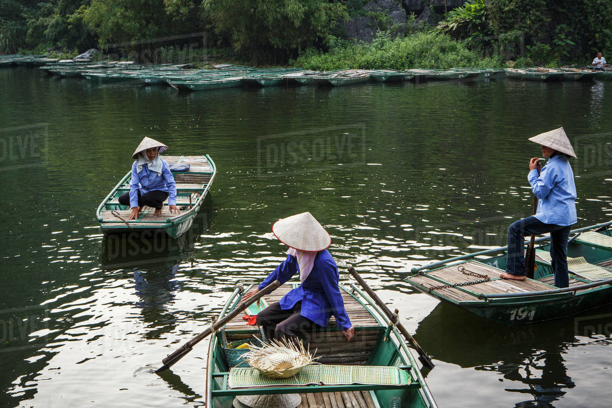 Local Guides Wait For Tourists in Trang An, Ninh Binh, Vietnam Royalty-free stock photo