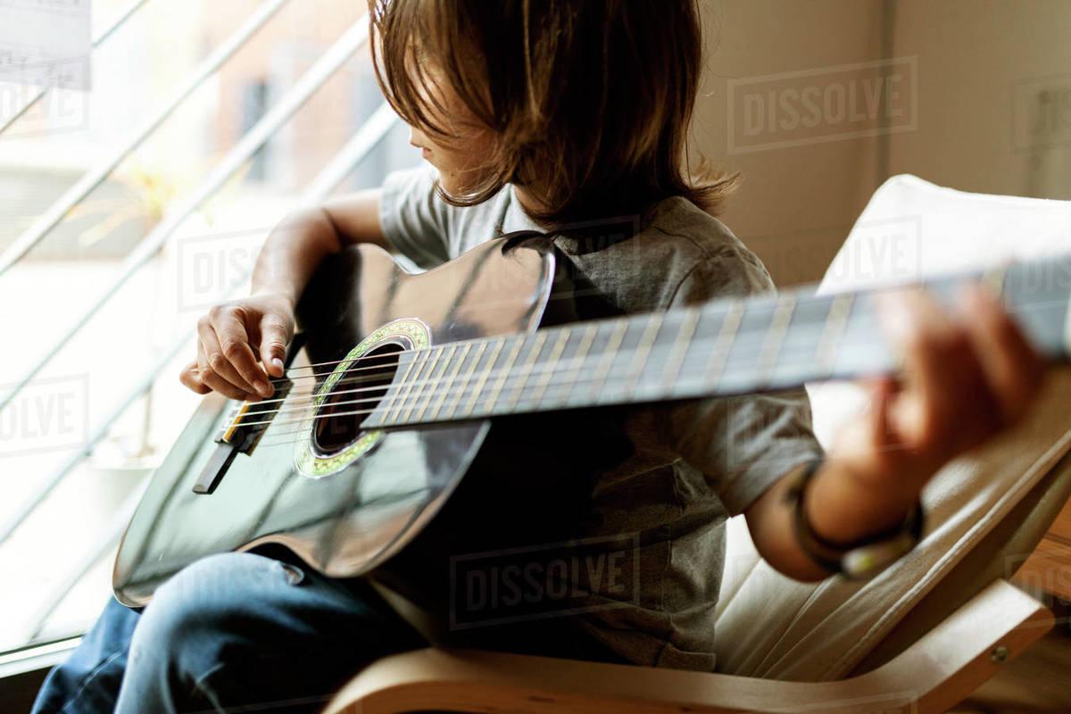 Teenage boy playing guitar Royalty-free stock photo