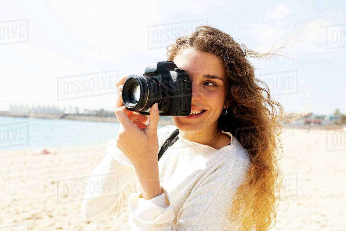 Happy young woman taking pictures in Barcelona beach Royalty-free stock photo