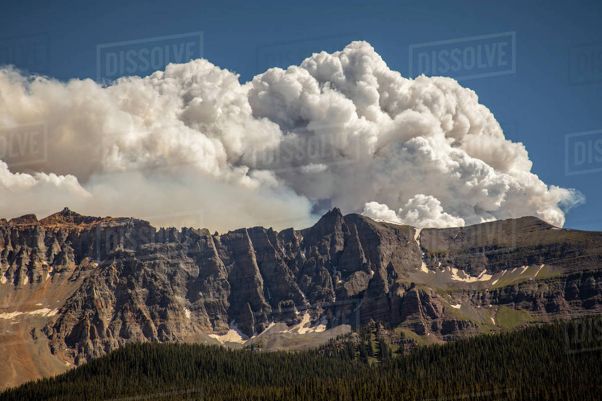 Smoke rising above the mountains from the 416 wildfire in Colorado Royalty-free stock photo