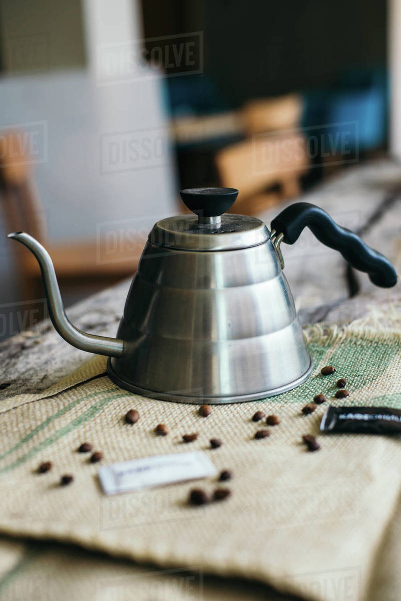 Coffee kettle on the old rustic wooden. Royalty-free stock photo