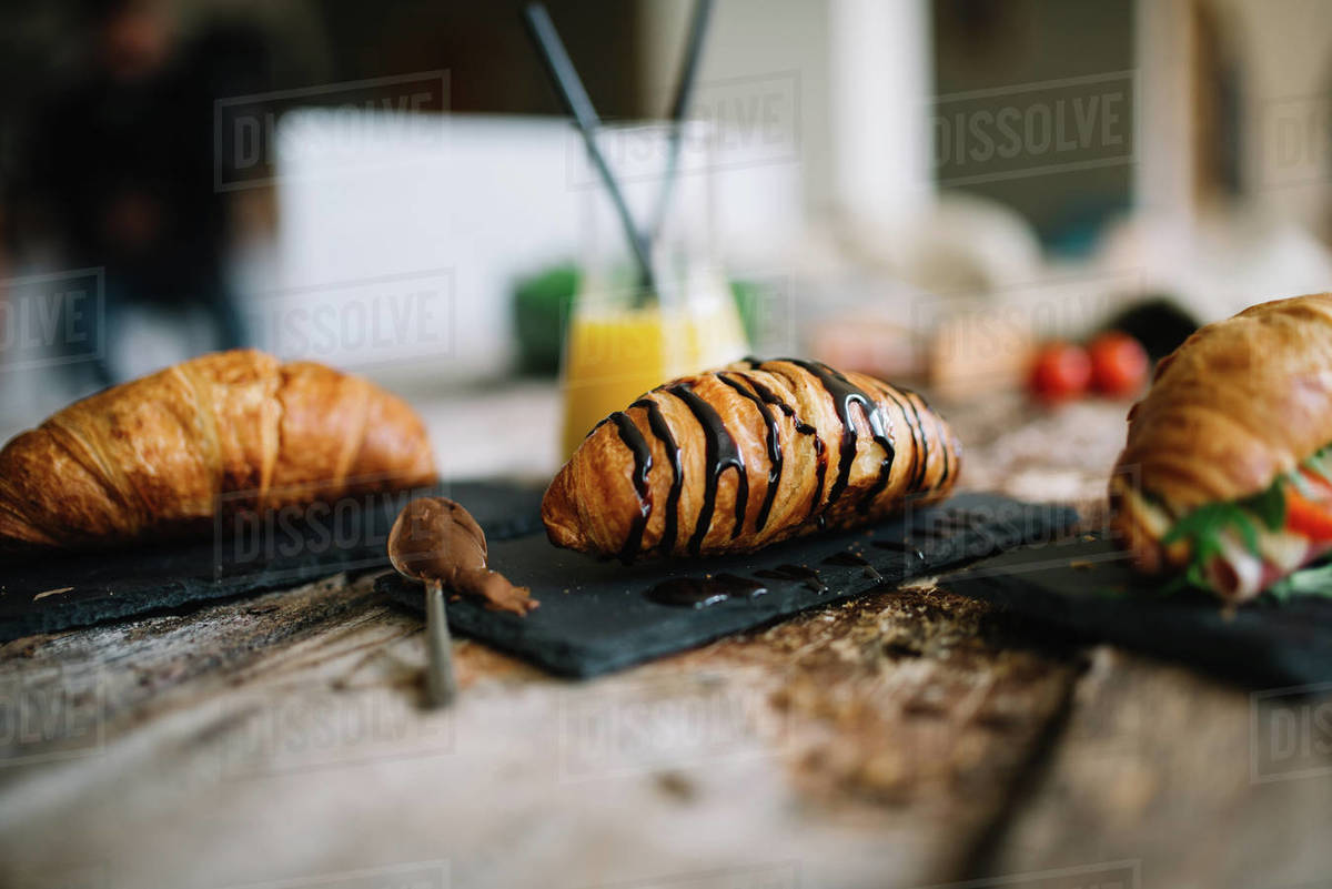 Croissant for breakfast on rustic wooden table. Royalty-free stock photo