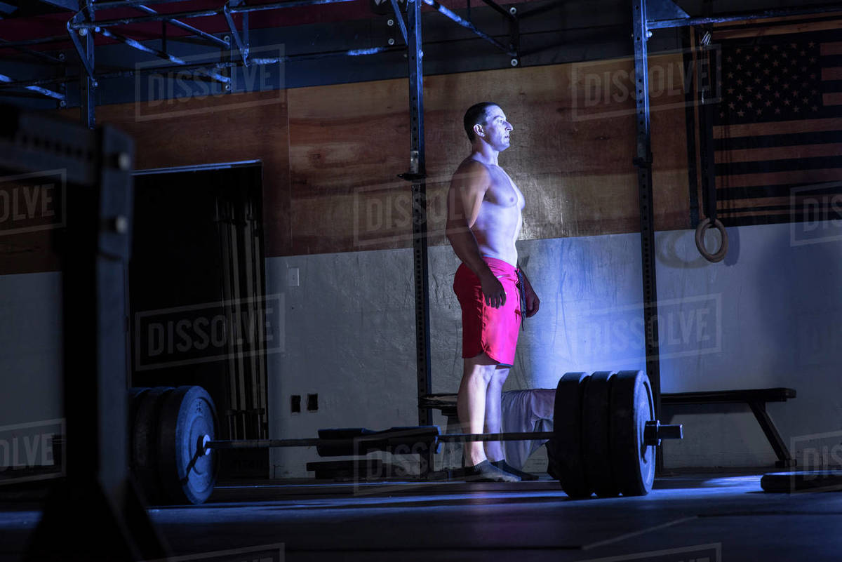 An athlete pauses before deadlifting at a warehouse gym in San Diego. Royalty-free stock photo