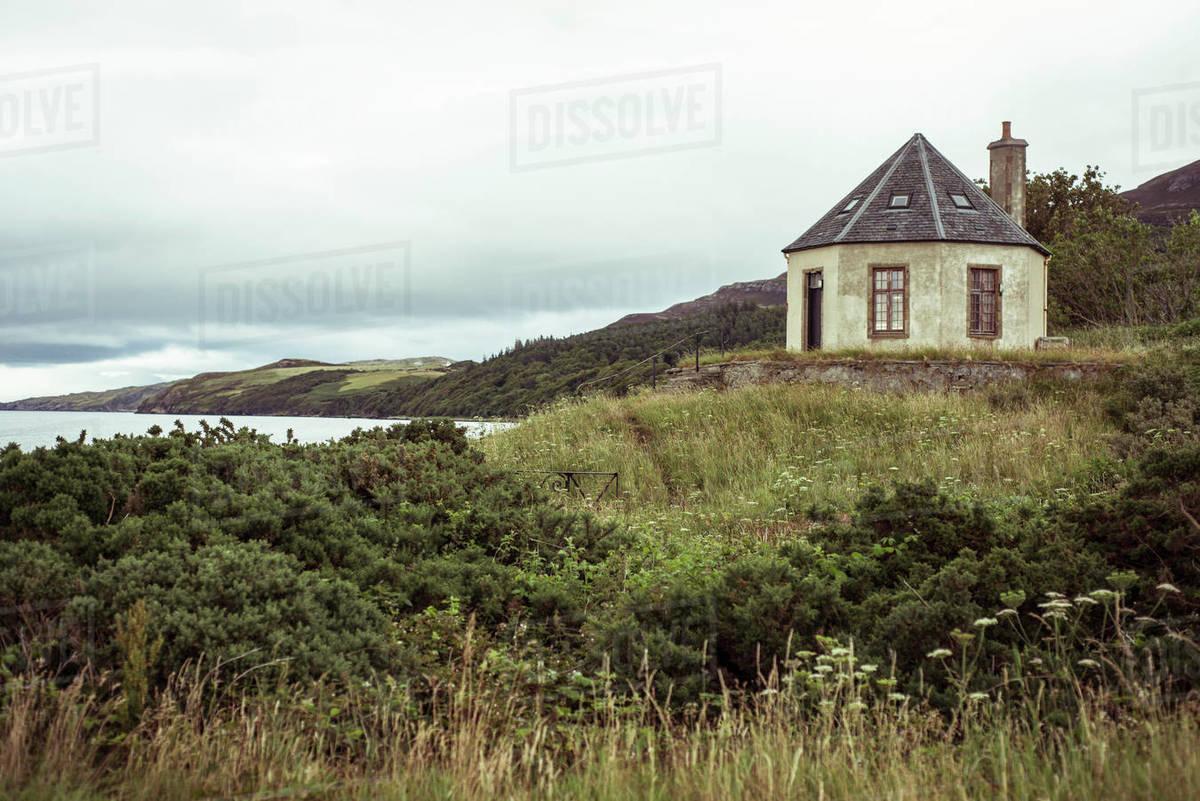 Small house on seashore coastline of Scotland Royalty-free stock photo