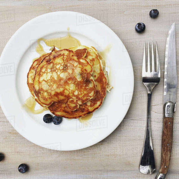 Overhead view of pancake with blueberries served in plate on table Royalty-free stock photo