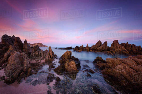 Scenic view of rock formations in sea against dramatic sky Royalty-free stock photo