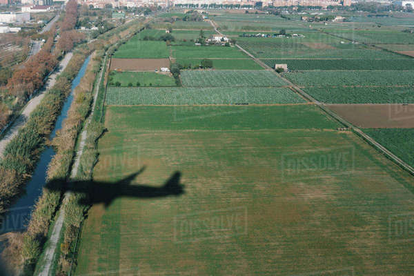 Aerial view of airplane shadow on landscape Royalty-free stock photo