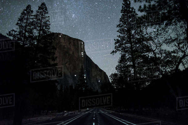 Country road leading towards mountain in Yosemite National Park at night Royalty-free stock photo