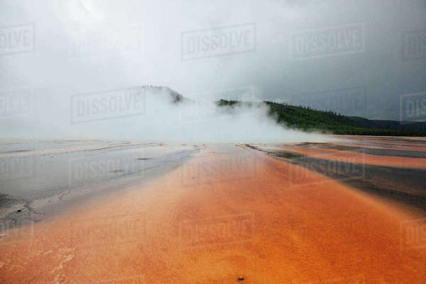 Grand prismatic spring against cloudy sky Royalty-free stock photo