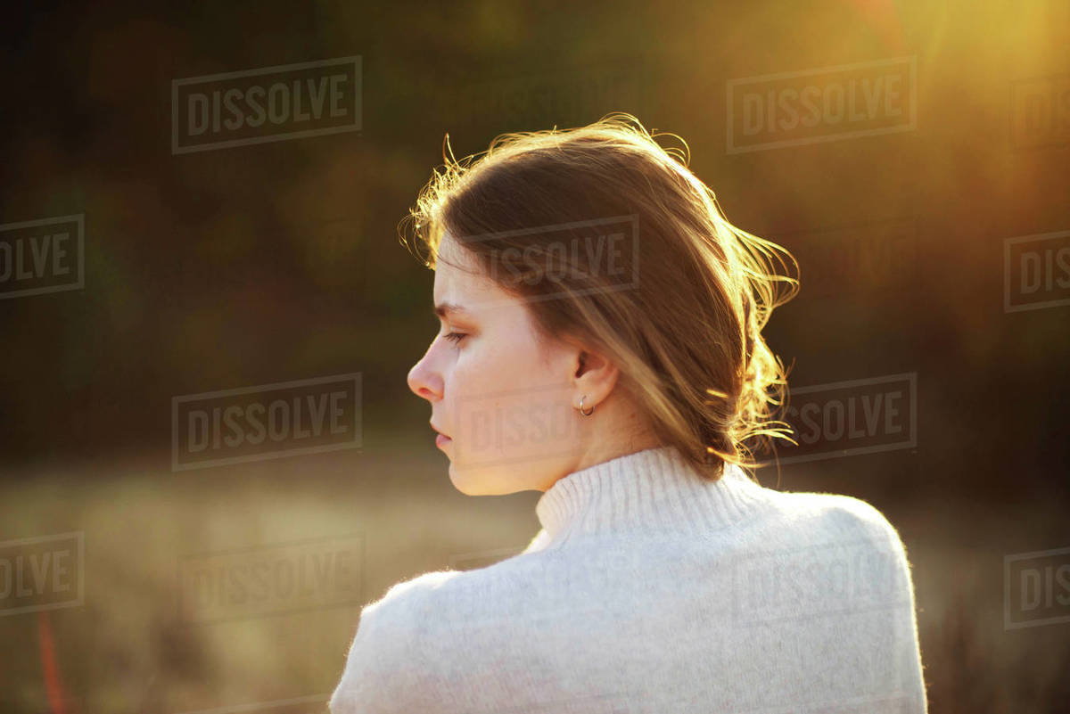 Beautiful portrait of a young stylish woman on a sunny day in au Royalty-free stock photo
