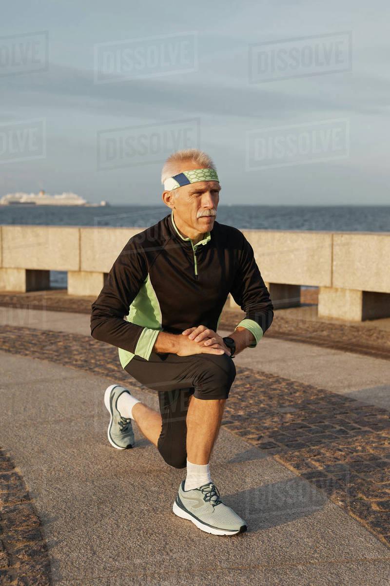 Senior Man Warming Up Before Jogging Royalty-free stock photo