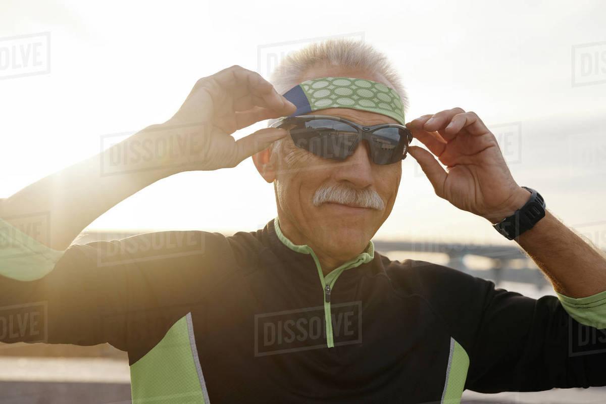 Sporty Senior Man Putting On Sunglasses Royalty-free stock photo
