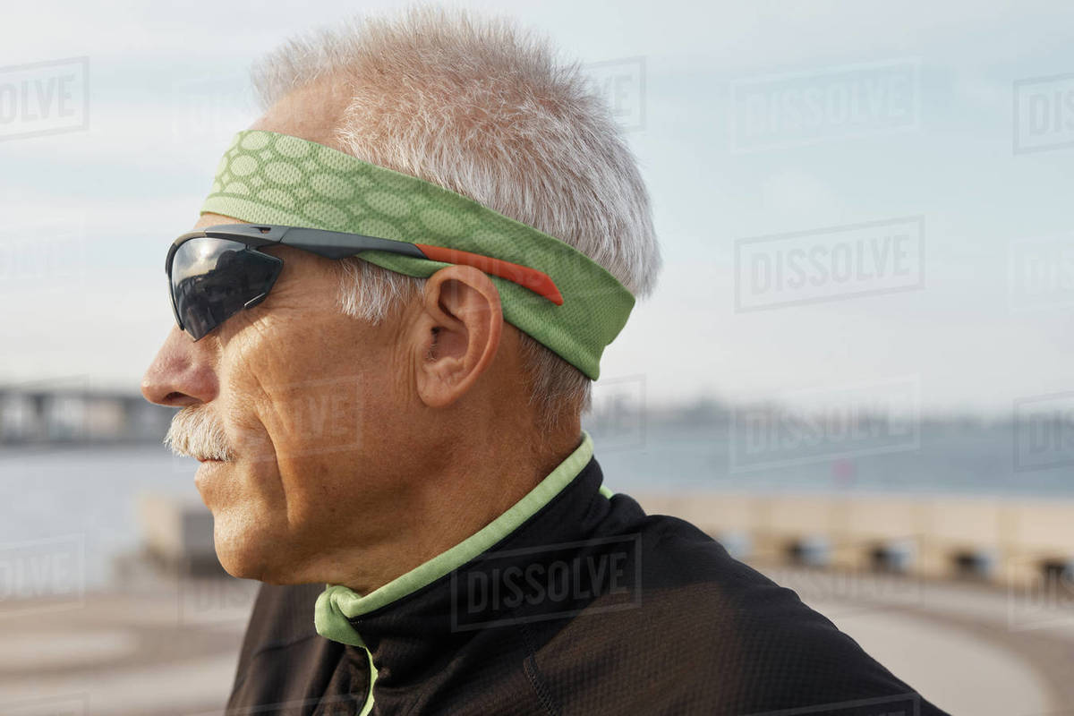 Senior Man In Sporty Outfit Side View Portrait Royalty-free stock photo