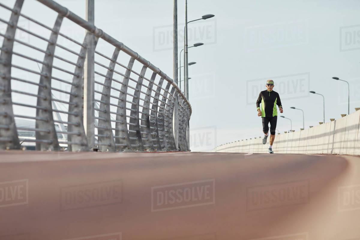 Modern Elderly Man Jogging Long Shot Royalty-free stock photo