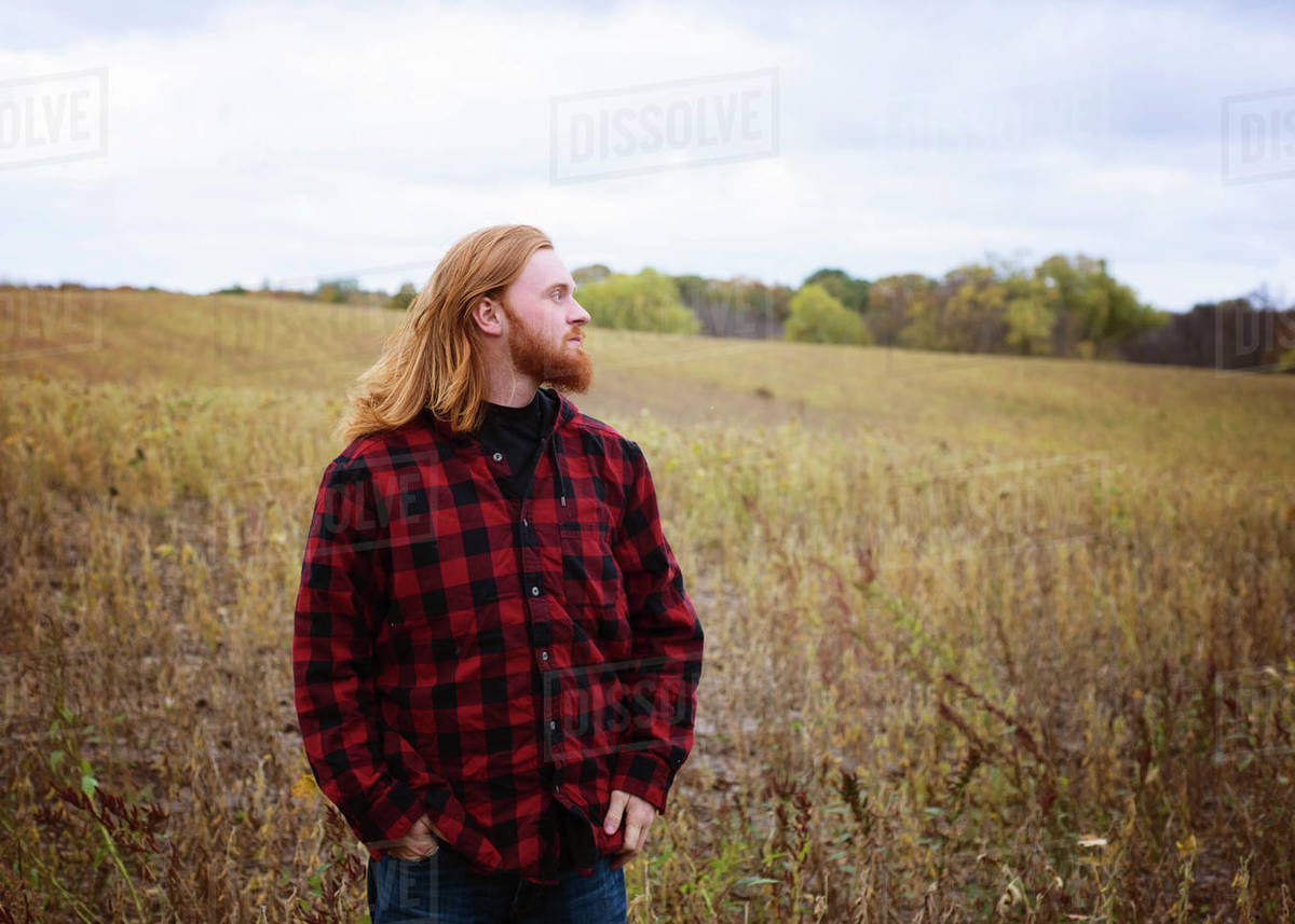 Young Man With Long Red Hair and Beard Outside in the Country Royalty-free stock photo