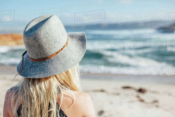 Woman standing on shore at beach Royalty-free stock photo