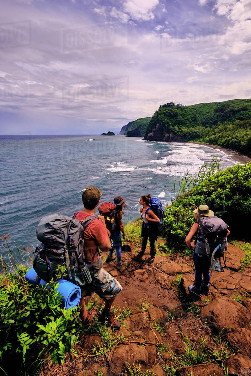 Backpackers hike through the Pololu Valley on the Big Island, Hawaii Royalty-free stock photo