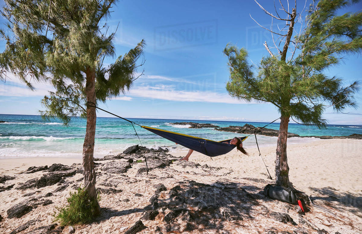 A woman relaxing in her hammock on Makalawena Beach, Hawaii Royalty-free stock photo