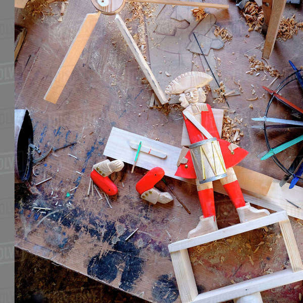 High angle view of drummer figurine on messy wooden table Royalty-free stock photo