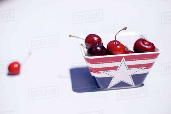 High angle view of cherries in bowl on table Royalty-free stock photo